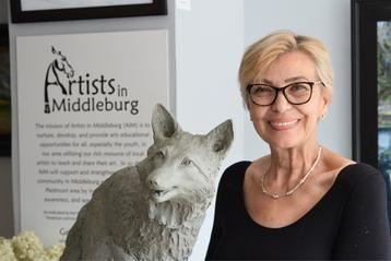 Artist with Fox Sculpture