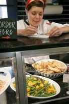 Woman Taking Order at Market Salamander (Photo Courtesy of Visit Loudoun)